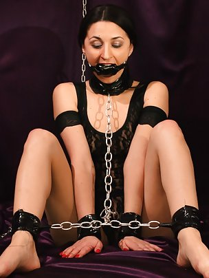 Pretty brunette cuffed and ball-gagged