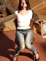 Damsel in distress chair-tied, ball-gagged, tit-grabbed