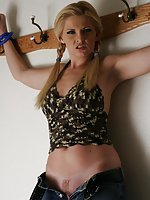Blond tied to the wall and humiliatingly undressed
