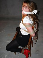 Lola is chair-tied and cleave-gagged
