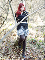 Redhead roped to the tree and ball-gagged