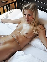 Cindy tied to a bed, teased and licked