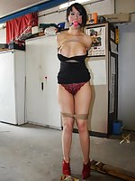 Leyla dangling on a string, firmly tied, ball-gagged, tit-grabbed
